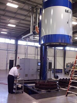 Man testing an industrial furnace and controls for accuracy